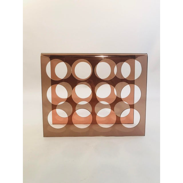 1960's Copper Tint Acrylic Wine Rack. Can hold up to 12 bottles of wine.