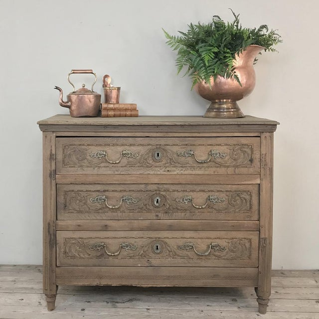 18th Century French Louis XVI Stripped Oak Commode represents time-honored craftsmanship and timeless style! Hand-crafted...