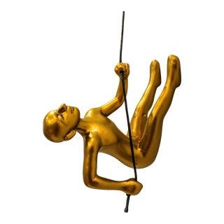 Gold Climbing Man Wall Art For Sale