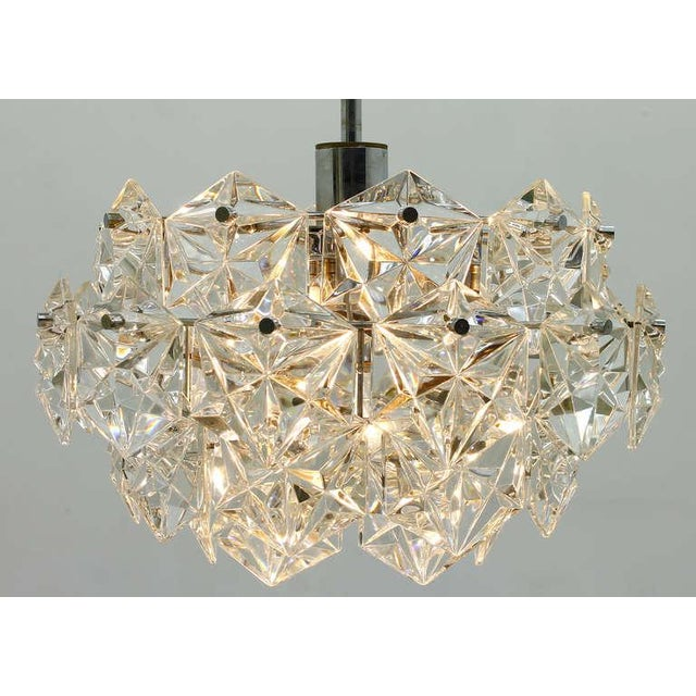 Four tiers crystal glass chandelier by Kinkeldey, Germany 1960s. Very good condition.