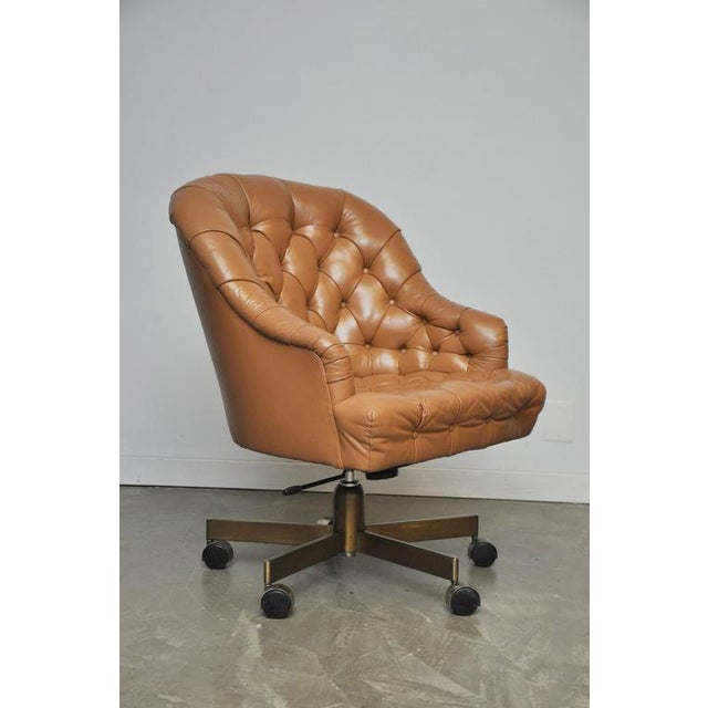 Classic leather Chesterfield tufted executive office chair by Edward Wormey for Dunbar. Original tan leather in excellent...