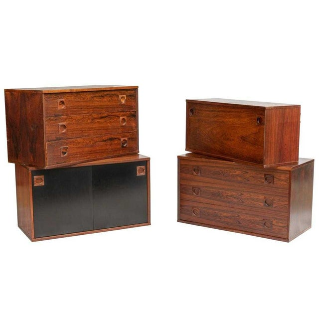Beautiful, large Danish rosewood wall unit with solid backs, attributed to Poul Cadovious. Made in the mid 20th century.