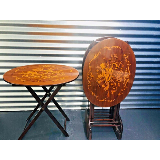 Last piece in stock beautiful new set of four folding nesting tables real wood and marquetry violin inlay oval shape....