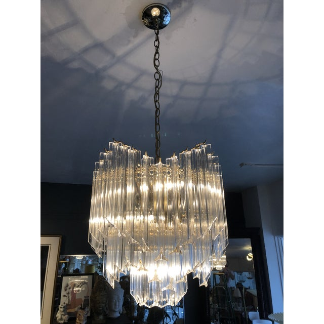 cac8001e24fa Amazing lucite chandelier with wavy pattern. Pictures show with only three  bulbs