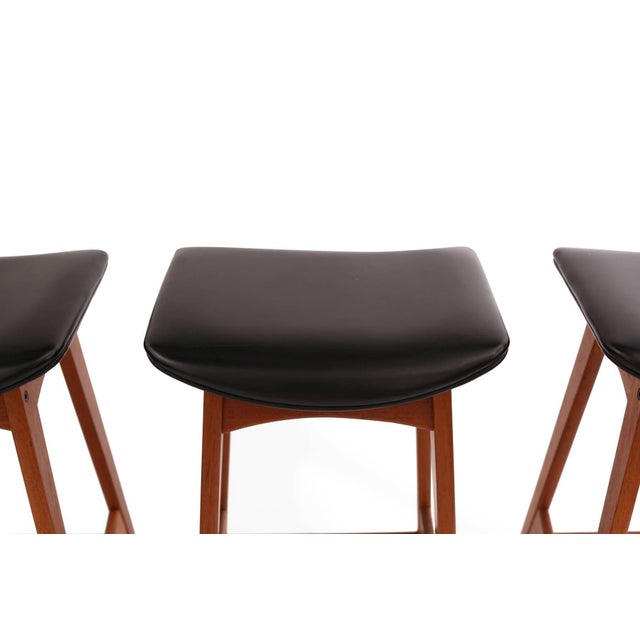 Four Johannes Andersen teak and leather barstools, circa early 1960s. These examples retain their original perfectly...