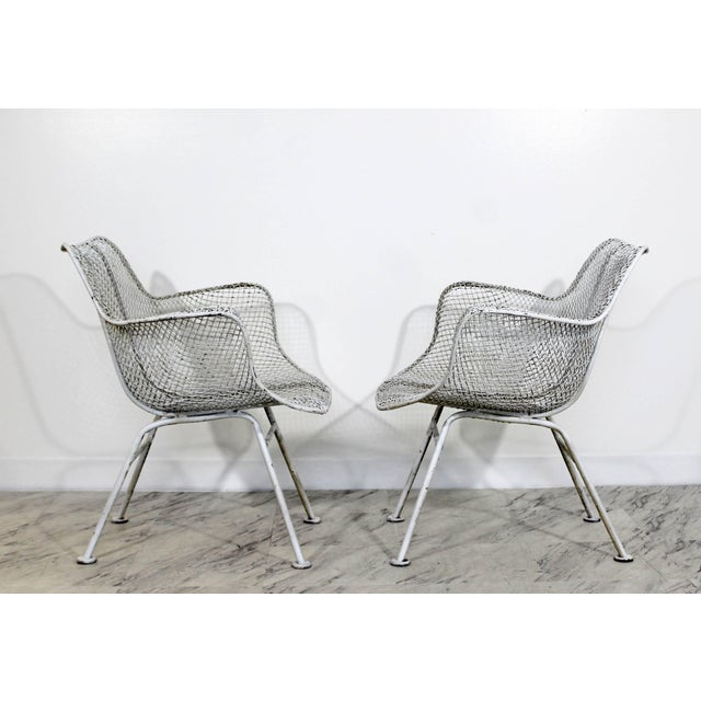 For your consideration is an incredible pair of white Sculptura outdoor patio armchairs, by Russell Woodard, circa the...