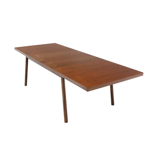 Very nice walnut dining table by Robsjohn Gibbings with two 2x18 Inches leaves.