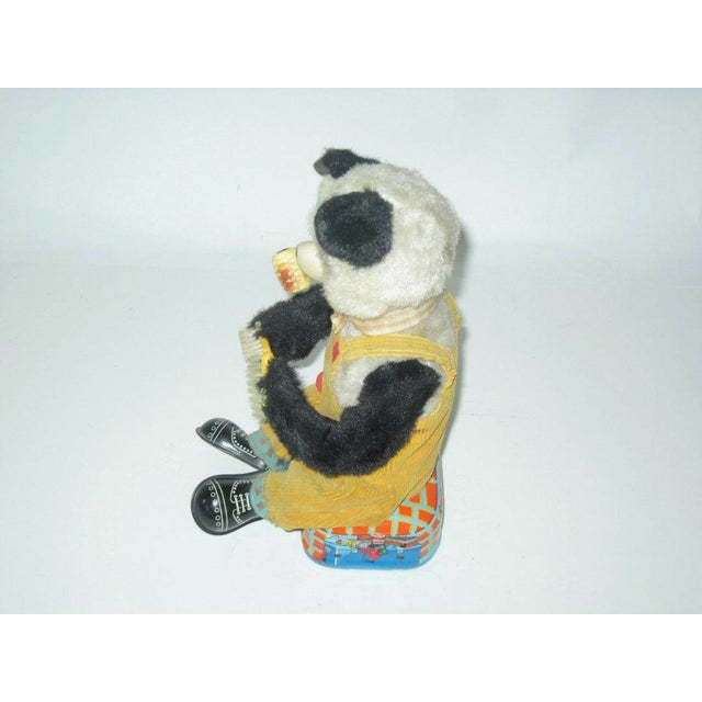 Shoe Shining Smoking Panda made in Japan c.1950s. This is a battery operated toy that uses two-DD batteries (not...