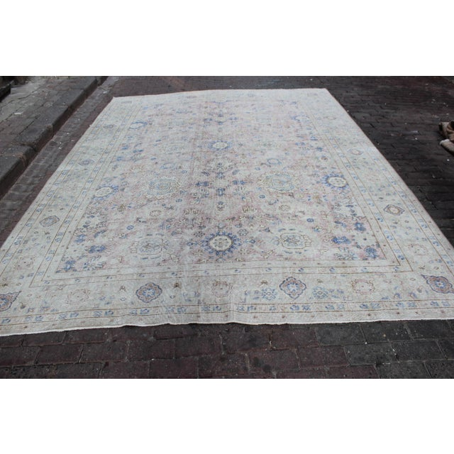 Antique Sivis Turkish rug, in hues of cerulean blue, silver, and dusty rose . Rug has been shaved and hand distressed to...