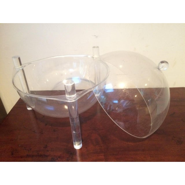 """I love this piece! Large covered bowl on Lucite """"legs."""" Use your imagination for what it can be used for: It was probably..."""