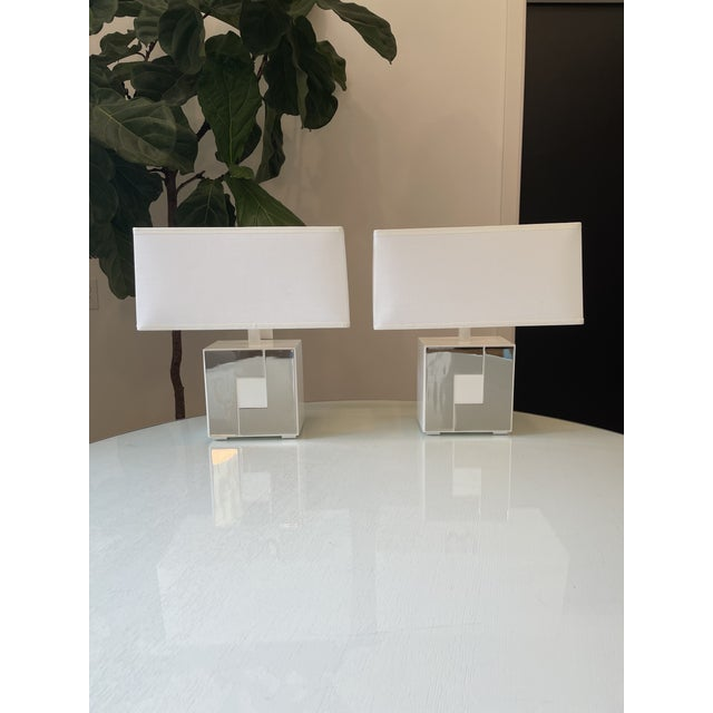 These cool chrome and white steel lamps have a heavy base with a mod vintage look but new construction. Rectangular shades...
