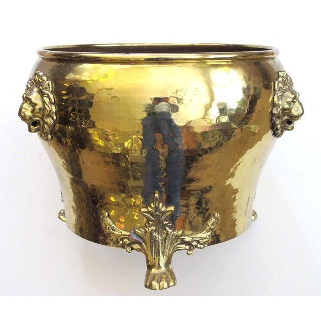 A rare and large-scaled Imperial Russian hand-hammered brass jardiniere with lion head mounts; Imperial Russia Stamp, City...