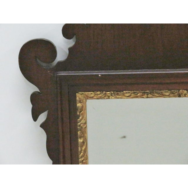 Mahogany frame with gilt shell motif and decorative gilt highlights around mirror.