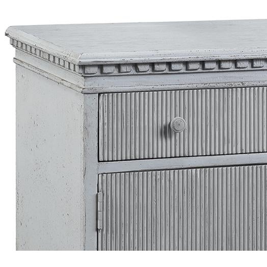 Grey painted carved wood side cabinet. Beautiful detail and distressed finish. Each is unique and may vary in exact...