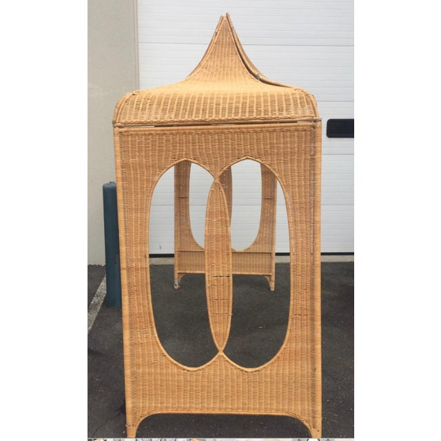 A Moorish rattan canopy to be used for architectural emphasis, perhaps for a daybed or area in a large room to be...
