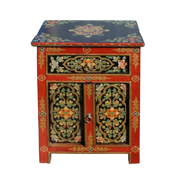 This cabinet / table is painted with colorful (orange red rim and black base ) Tibetan style flower graphic at the front ,...