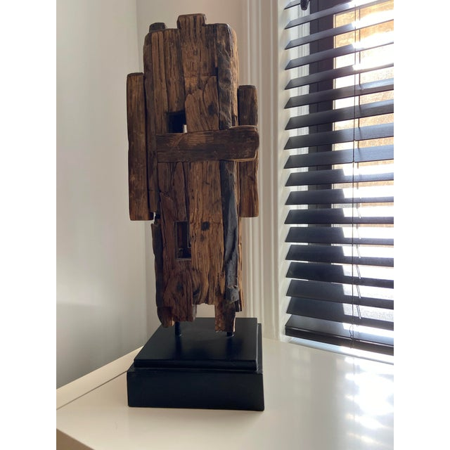 Natural Wooden Sculpture in Mid Century Style, with Black wooden base. Item is 3 years old, with now damages or defects.
