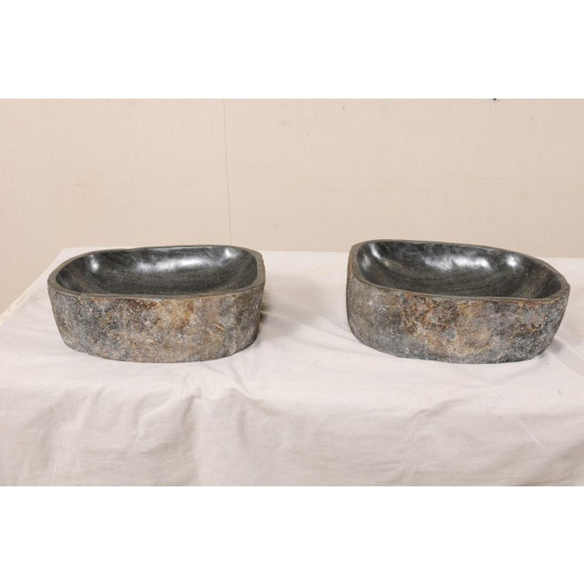 A pair of river rock wash basins. This pair of sinks have each been carved from a single, natural river rock boulder. Each...