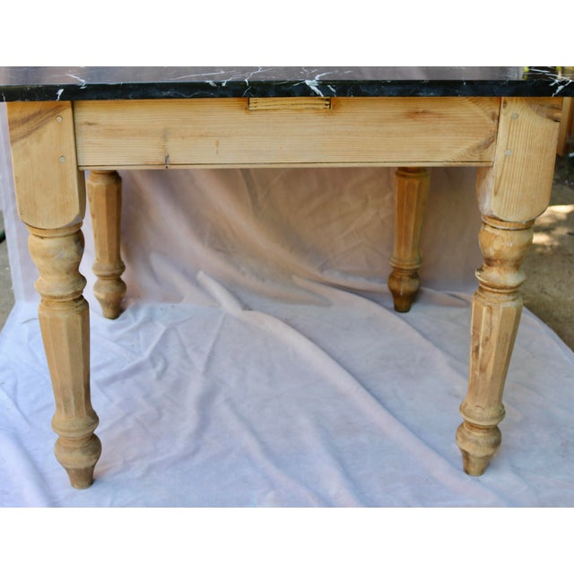 A Vintage French Farm Table with a Marble Top. At some time in the past the Table Base was cut down from a larger...