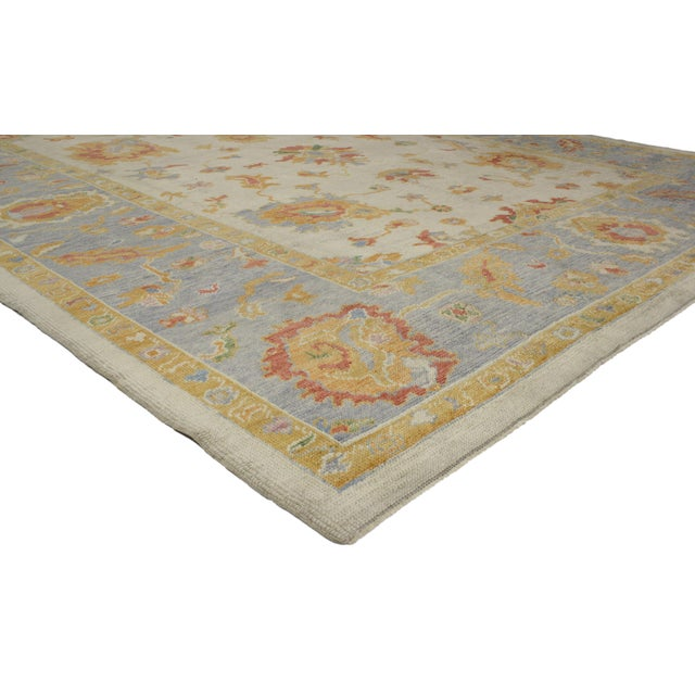 Highly stylish yet tastefully casual, this contemporary Turkish Oushak rug with pastel colors and tribal boho chic style...