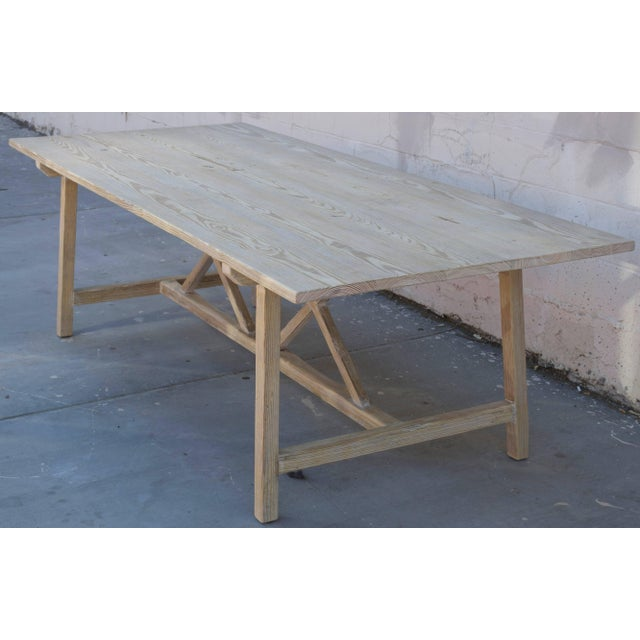This vintage pine farm table has splayed legs with nicely worn planks and patina. Because each table is bench-made in our...
