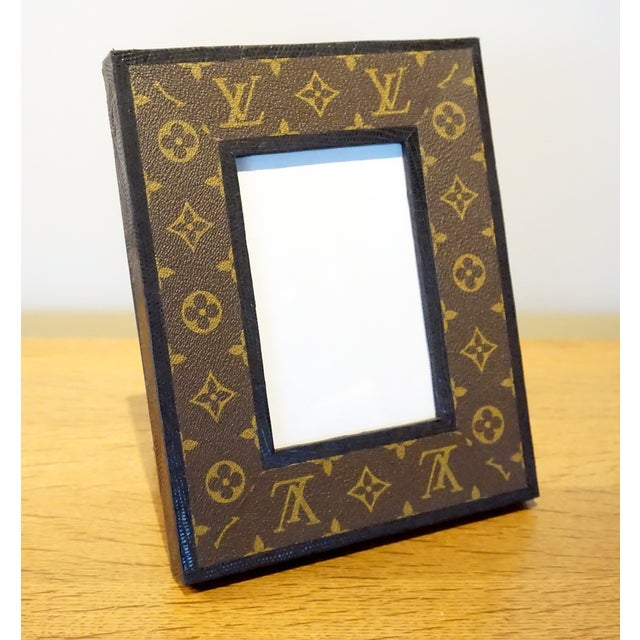 A beautifully handcrafted, contemporary photo frame covered in vintage, Louis Vuitton luggage material and dyed American...