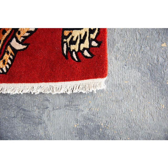 Early 21st Century Vintage Red Wool Tiger Rug- 2′ × 3′3