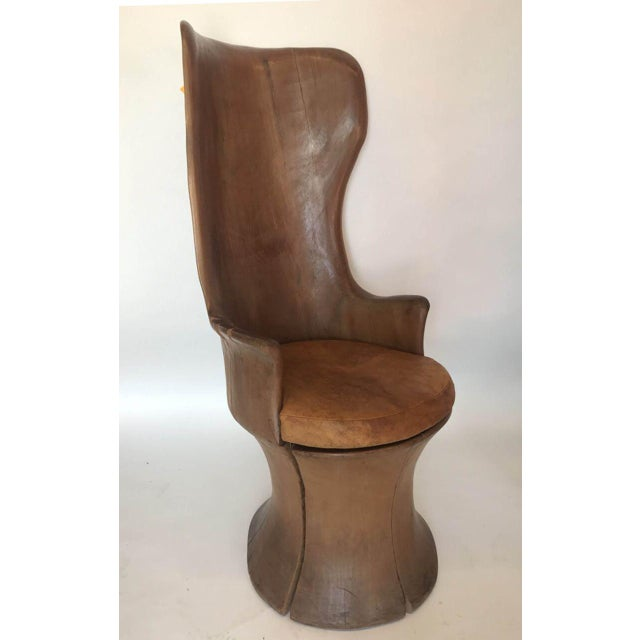 Sitting in this chair is like being inside a cocoon. It's large and surrounds you. The carver had a sense of humor when...