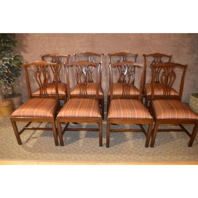 Set of Eight Vintage Dining Chairs. These chairs are solid Mahogany and have a Stretcher Base. The chairs have been newly...