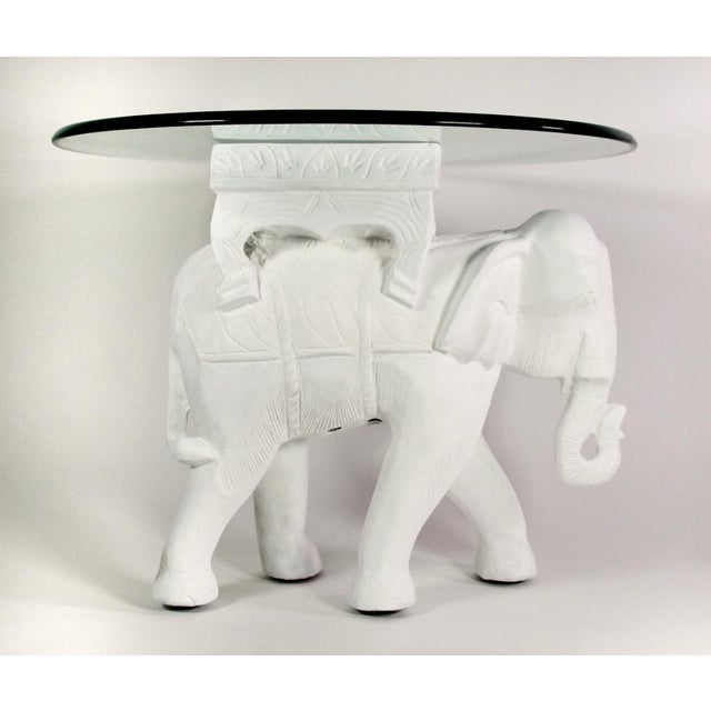 Base is carved from a solid piece of teak wood and covered in layers of gesso in the form of an elephant. Base sculpture...