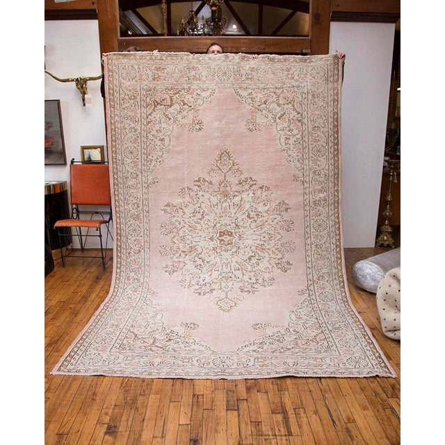 A beautiful vintage Turkish rug that has been reworked and given new life with an infusion of modern color through an...