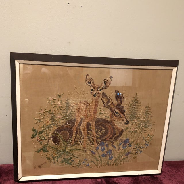 Beautiful antique Crosstitch to pick thing though and fun. This piece has beautiful muted colors and is actually signed by...