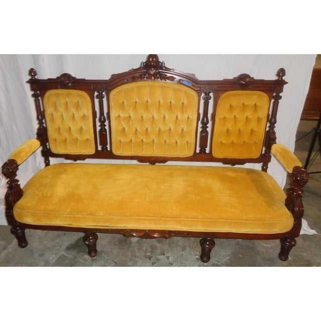 This three-seater Edwardian Sofa features a bright, yellow-gold upholstery, perfect for brightening up a room!