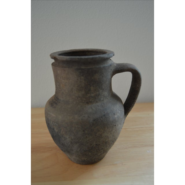 Historically, these small, one-handled pots were used for serving and cooling wine. This beautiful Koyroypa terracotta...