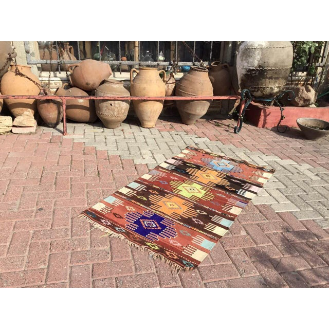 Beautiful, vintage, handwoven kilim is approximately 60 years old. It is handmade of wool and acrylic. It has been...