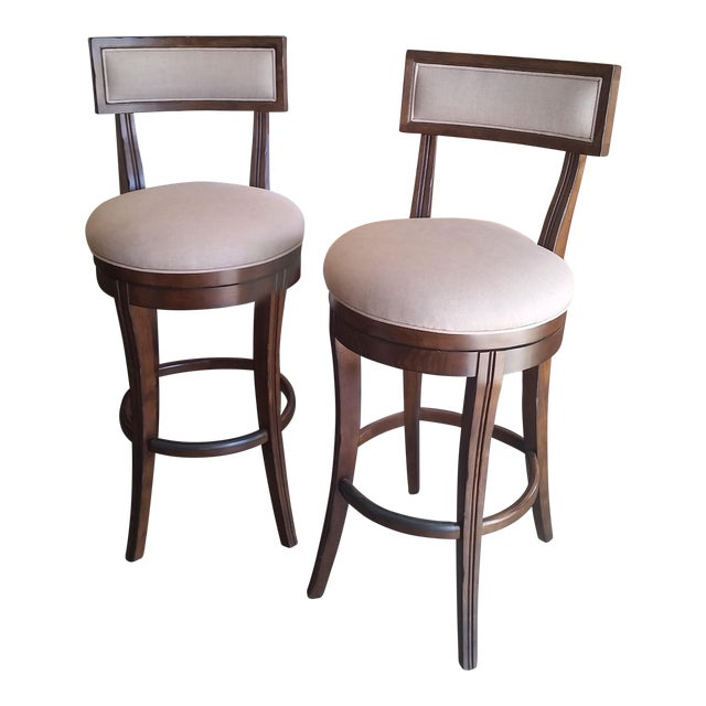 Caracole Hi-Ho-Hi Dark Swivel Bar Stools - A Pair For Sale