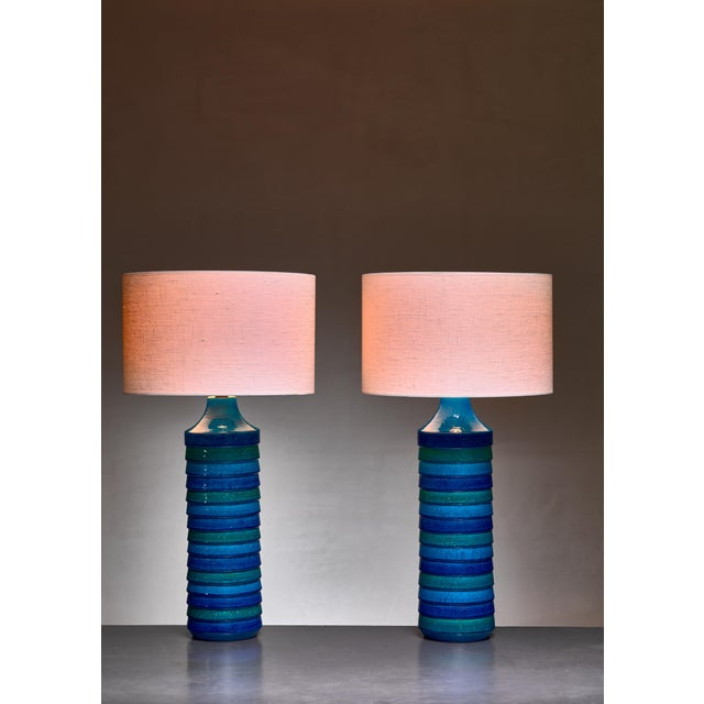A pair of large Italian floor or table lamps by Aldo Londi for Bitossi. The lamps are made of ceramic with a blue and...