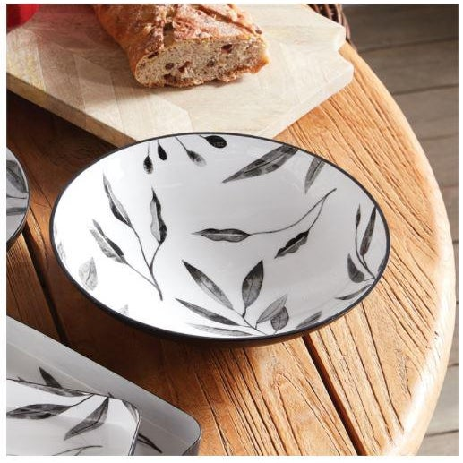 The Leaf Serving Bowls - Set Of 2 In a stark juxtaposition of shiny white enamel and black matte, our Leaf collection is...
