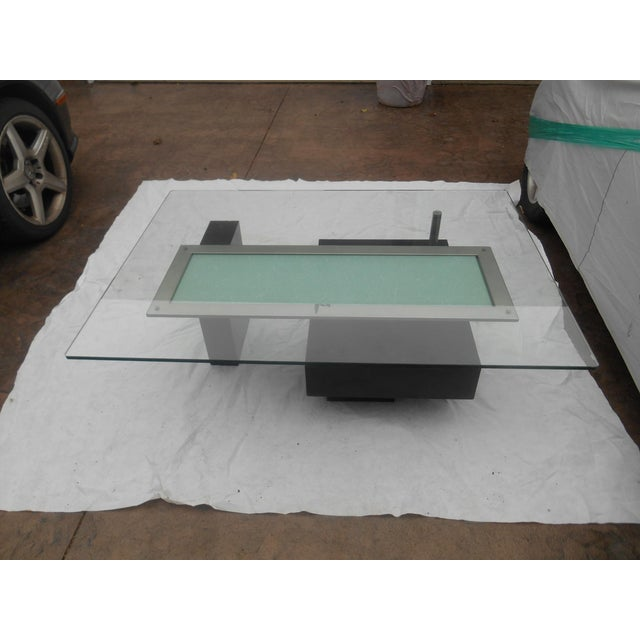 Awesome vintage MCM contemporary abstract cityscape style coffee table with glass top. The metal arms are a satin platinum...
