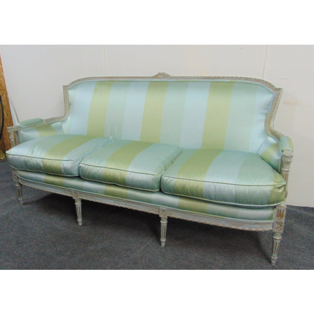 Louis XVI style sofa . Hand carved frame with blue distressed painted finish, Newly Upholstered blue and greens stripped...