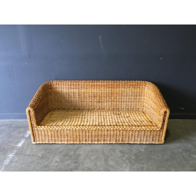 Vintage wicket sofa in the manner of Michael Taylor made in Hong Kong. Really clean, modern lines.