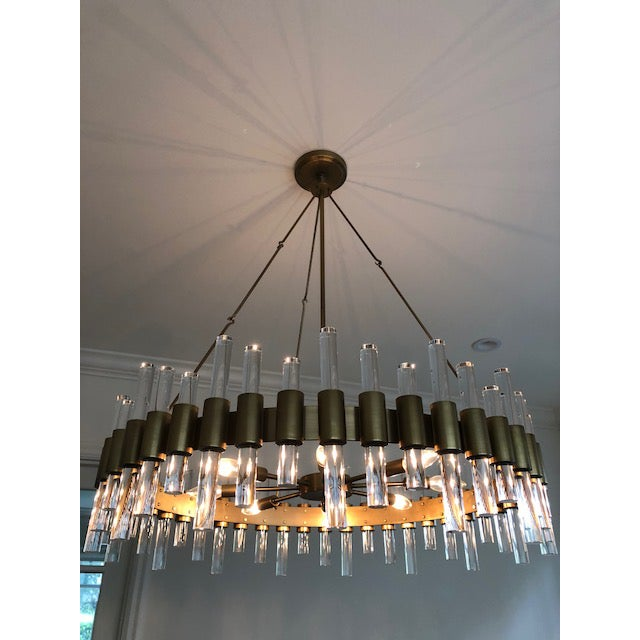 Antique brass and acrylic are the perfect pair on this eight-light chandelier. Approved for use in covered outdoor areas....