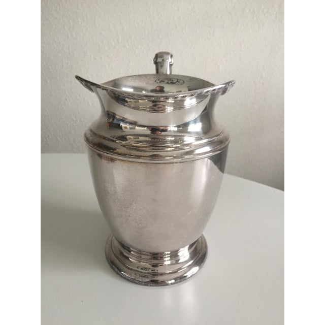 This beautiful antique English silver water pitcher features a Neo-classical border design and scroll handle. Heavy and...