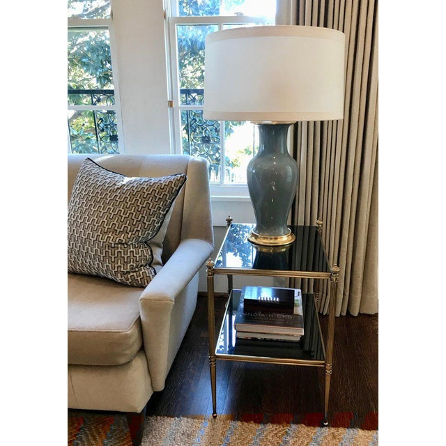 Pair of duck egg blue colored ceramic lamps on custom 23-karat water double gilt turned wood bases. Phoenix tail form...