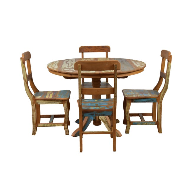 Very inviting, this unique dining table blends to perfection the charm of rustic reclaimed peroba rosa wood and elegant...