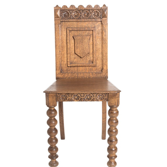 Antique, Germanic hall chair-beautifully handmade. Carved back with shield and carved front apron. 19th century.