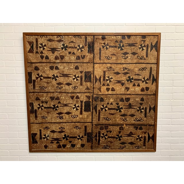 Bark cloth / Tapa Cloth mounted on plywood and trimmed in Mahogany. Bark cloth, or tapa, is not a woven material, but made...