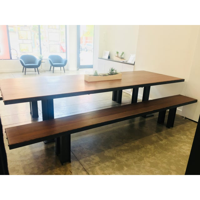 A beautiful 10-foot long table that was constructed of wood from reclaimed bowling lanes. It is 3 1/2 feet wide, the...