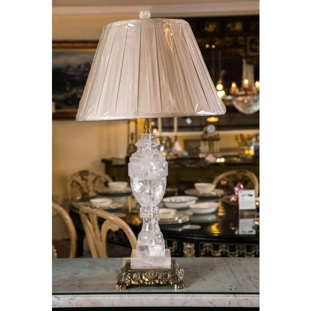 A fine rock crystal single column lamp on bronze base. Recently wired. Without shades.