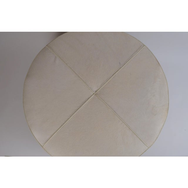 White Hide and Patinated Brass 'Tambour' Ottoman by Design Frères. The last picture is of a different version of the...